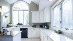Clean Kitchen with White Countertops and Houseplants