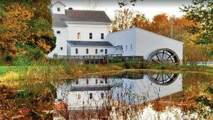 Beautiful side view of the Wolcott Mill Metropark Farm House in Fall